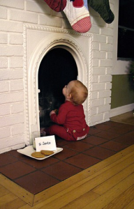 babybyfireplace 192x300 Ideas For Cute & Clever Christmas Card Photos